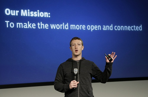 FILE - In this Thursday, March 7, 2013 file photo, Facebook CEO Mark Zuckerberg speaks at the company's headquarters in Menlo Park, Calif. Facebook wants to get more of the world's more than 7 billion people online through a partnership with some of the world's largest mobile technology companies. Facebook Inc. announced a partnership called Internet.org on Wednesday, Aug. 21, 2013. (AP Photo/Jeff Chiu)
