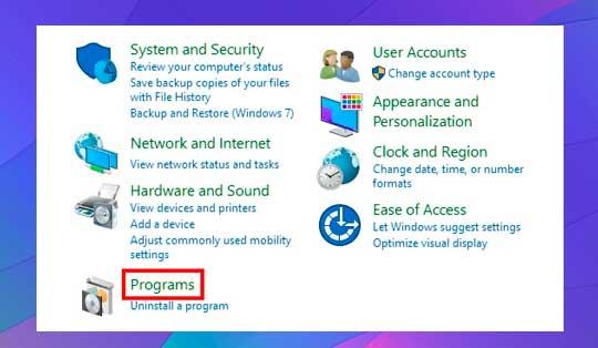 Panel de control y haga clic en Programas
