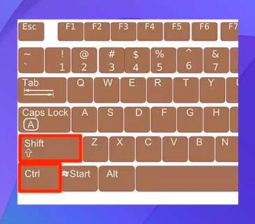 Mantenga pulsados los botones Mayús y Ctrl del teclado